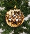 Flot kobberfarvet kugle dekoreret med mønster.