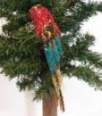 Flot papegøje med clips dekoreret med pallietter og glimmer.