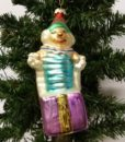 Sjovt ophæng af en klovn der springer op af en gave.